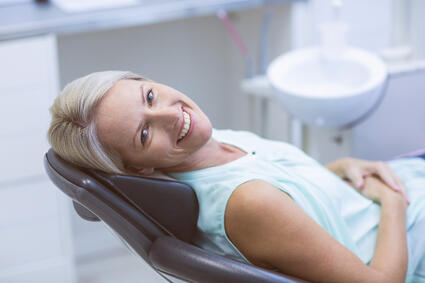 Dental Implants vs. Dentures: The Pros and Cons