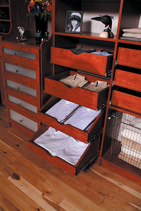pull out drawers open and filled with folded clothes