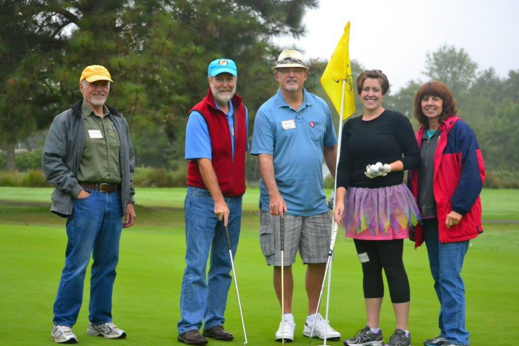 Alan Scott (center) and fellow Mid-Valley Literacy Center staff members having a blast during a company fundraiser.