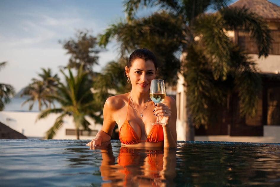 beautiful-woman-relaxing-in-a-swimming-pool-J4PWL5N