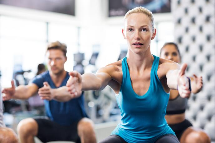 woman-exercising-in-gym-P5K6H93-min