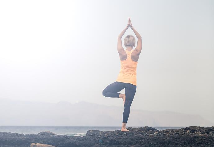 yoga-girl-meditating-and-relaxing-in-yoga-pose-P3TZ6DU-min