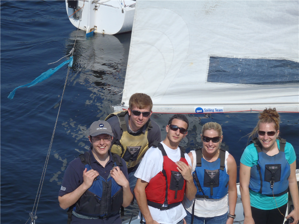 Coach Kieran, Ryan Detzel, Peter Nunes, Amy Smith and Amanda Buchholz aboard the J22 they named Shamu.