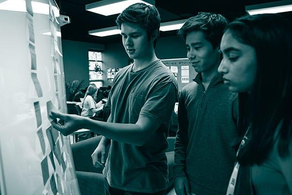 Three students brainstorming