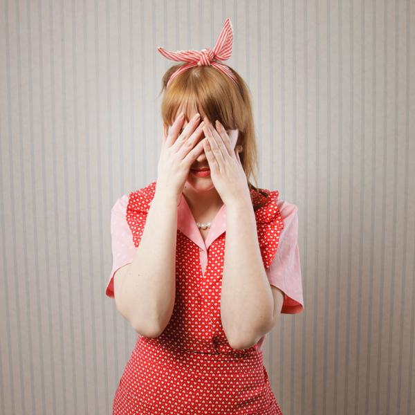 woman_burying_her_head_in_her_hands.jpg