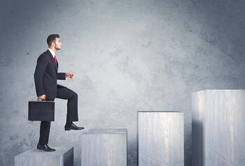 Business person stepping up a staircase-2