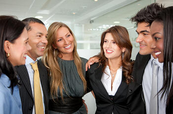 Group of business people smiling together in an office