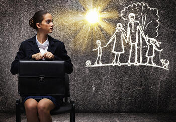 Young upset businesswoman sitting on chair with briefcase