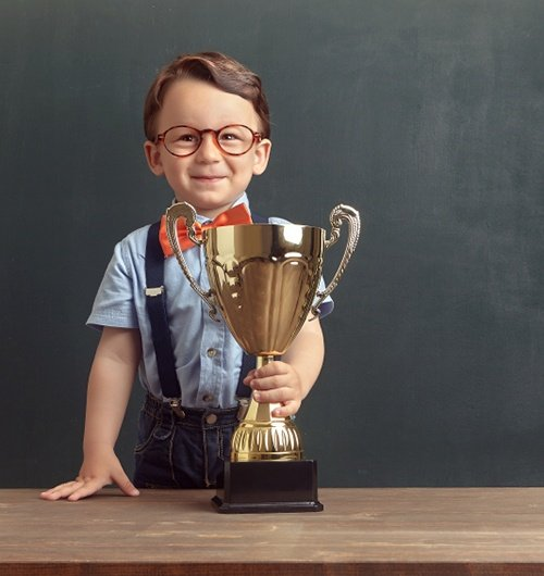 Kid_w_Trophy_cropped_home.jpg