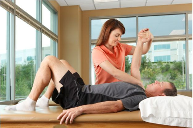 Chiropractor examining a patient with restricted should range of motion
