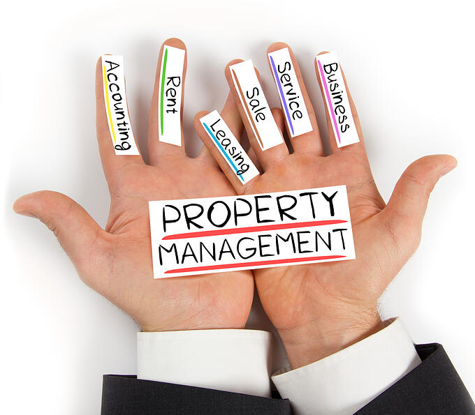 property management concept, property management services written on hands.