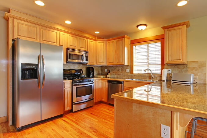 Golden maple cabinets kitchenw with new appliances