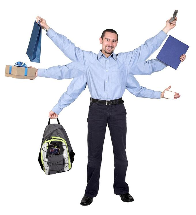busy businessman over a white background - 6 arms showing all the tasks he has to do