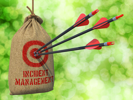Incident Management - Three Arrows Hit in Red Target on a Hanging Sack.