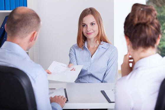 Young pretty woman and the beginning of her job interview