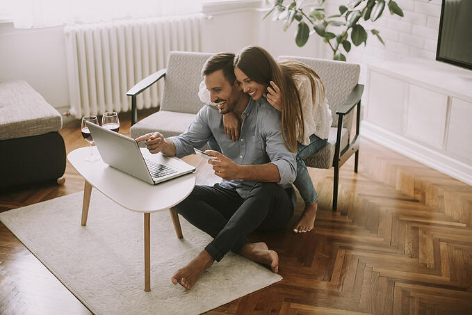 Cheerful Couple Searching Internet Shopping Online Living Room Home