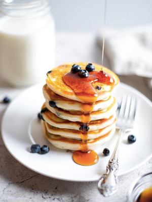 Classic stacked pancakes with fresh blueberries and maple syrup.  Photo:  ForkinPancakes