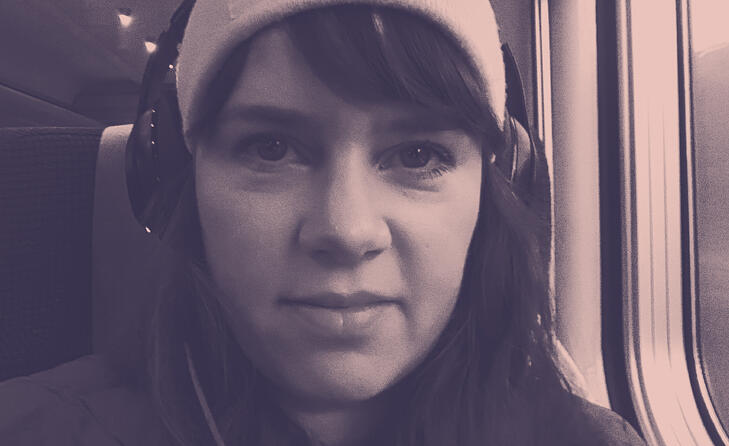 Woman in train with headphones