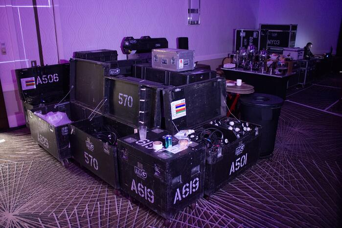 a grouping of empty dead cases being stored together backstage at a live event