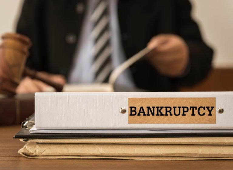 bigstock-Bankruptcy-Document-Folder-Wit-226989730-768x562