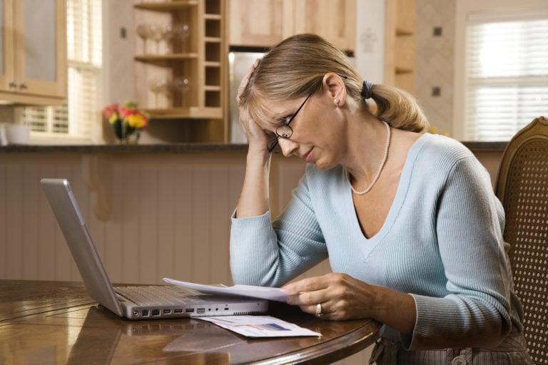bigstock-Caucasian-mid-adult-woman-payi-12817523-768x512