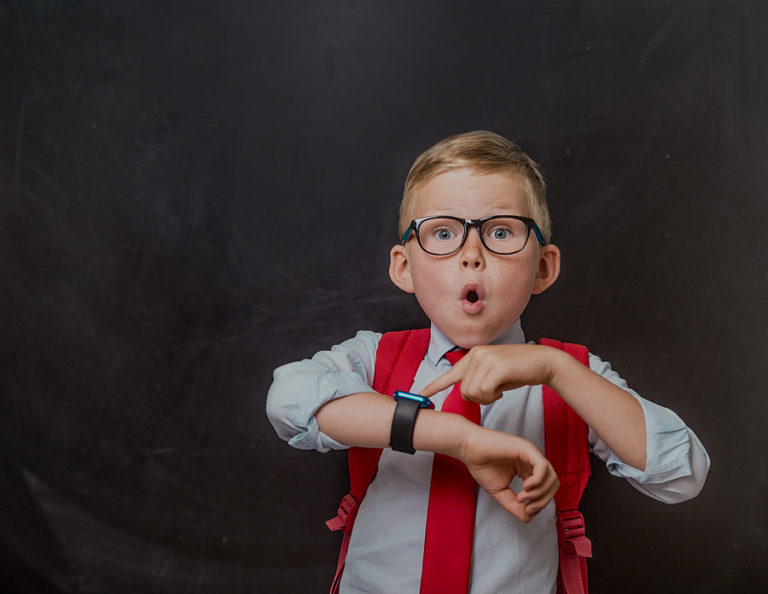 bigstock-School-Kid-In-School-Uniform-A-378370147-768x594