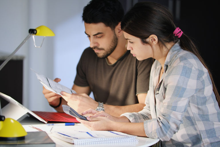 bigstock-Young-Couple-Reviewing-Invoice-249209005-768x512