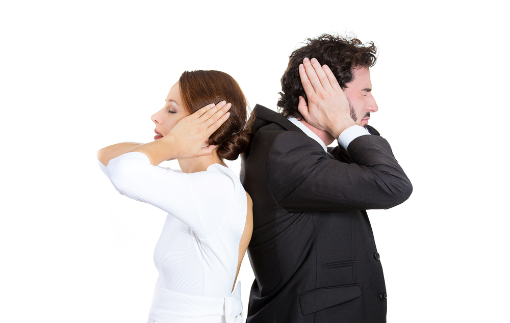 Closeup portrait of man woman couple standing with backs together covering ears, closed eyes, not listening to each other isolated on white background. Negative human emotions facial expressions