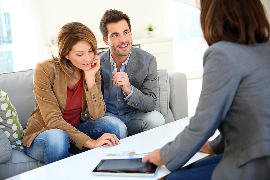Couple meeting financial adviser for real estate project