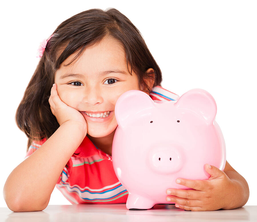 Little girl saving money in a piggybank - isolated over a white background