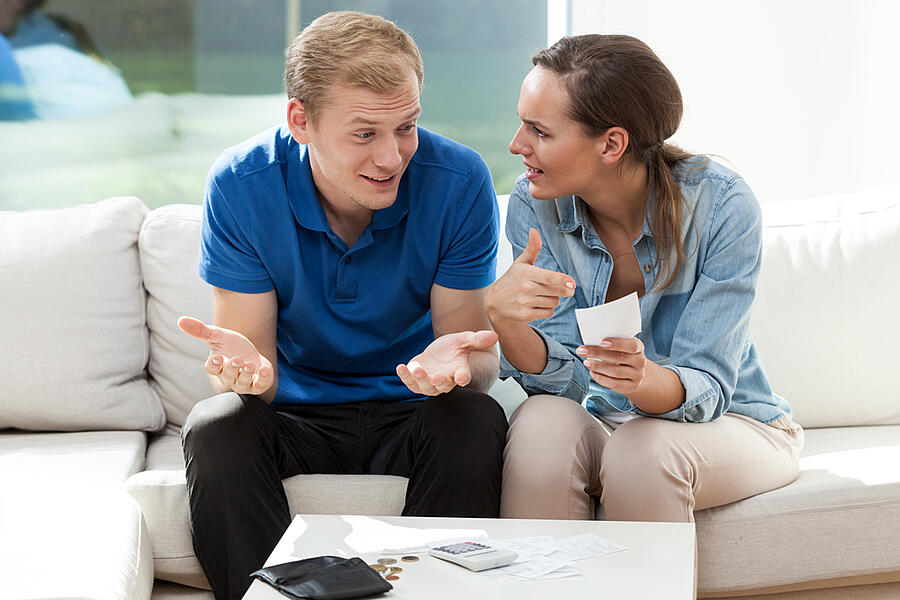 Portrait of young couple not having money
