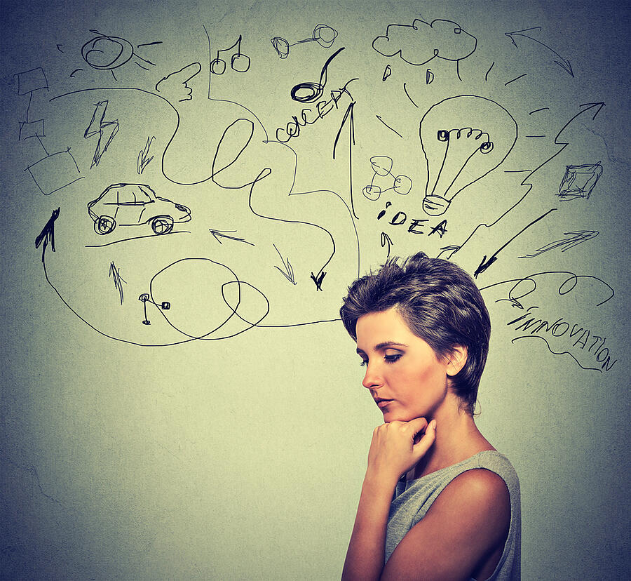 Portrait worried young woman thinking dreaming has many ideas looking down isolated grey wall background. Human emotions feelings life perception. Decision making process concept.