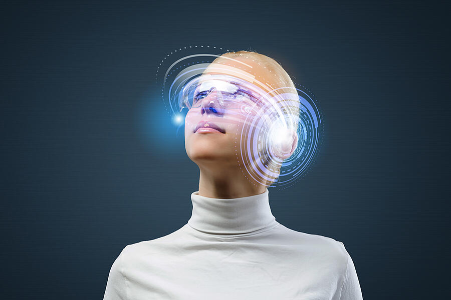 Young woman in white with hologram round head