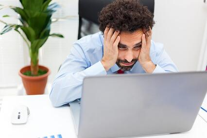 Man-feeling-frustrated-at-computer-1424x949