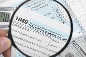 United States of America Tax Form 1040 with magnifying glass