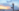 woman standing on the the beach in yoga position offering health and corporate wellness jobs online