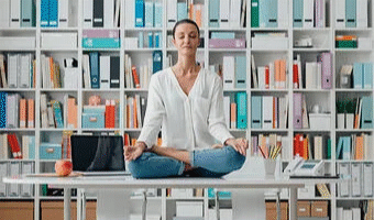 Woman sitting on desk learning how ow to relax your mind, learning to unwind