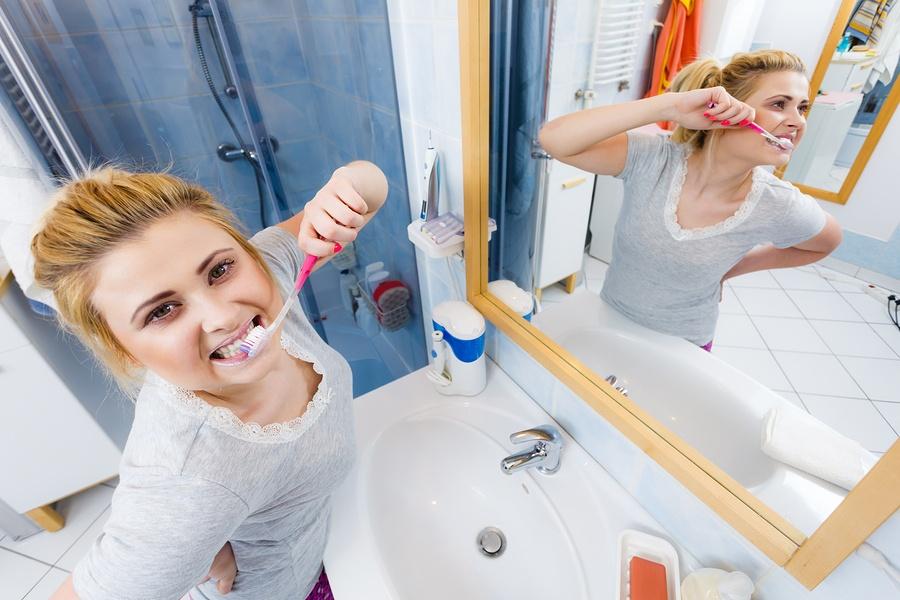 bigstock-Woman-Brushing-Cleaning-Teeth--185987347.jpg