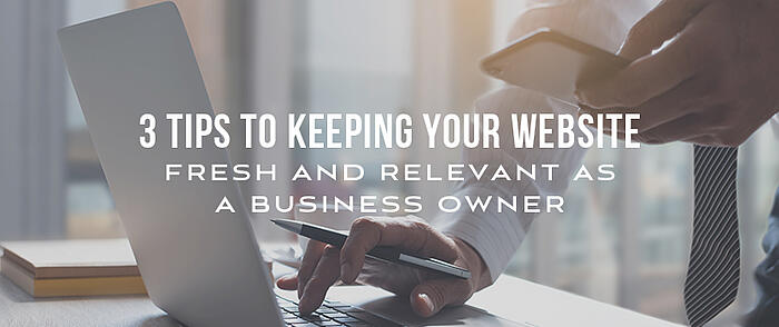 "Businessman using laptop and cell phone with overlaid text that reads, ""3 Tips to Keeping Your Website Fresh and Relevant as a Business Owner"""