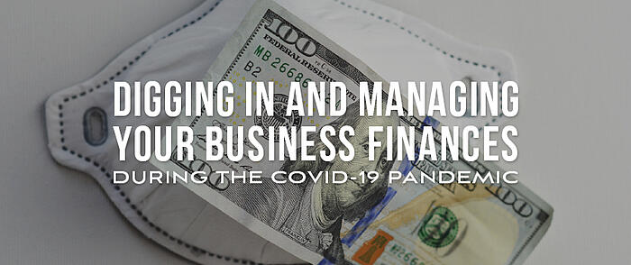 "Surgical face mask and a $100 bill laying on top with overlaid text that reads ""Digging In and Managing Your Business Finances During the COVID-19 Pandemic"""