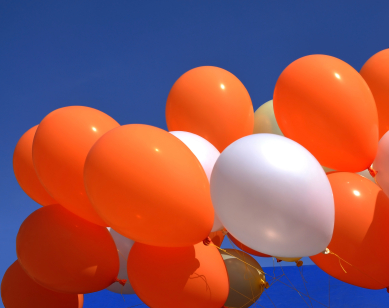 orange white balloons sky