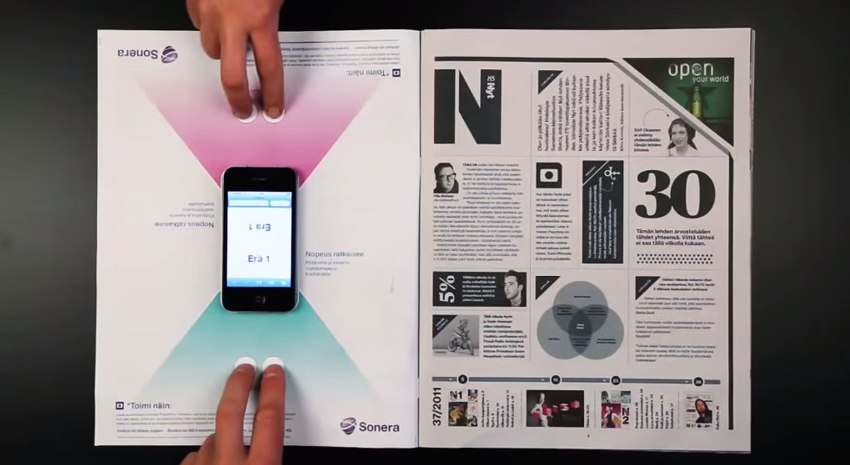 Interactive print advertisement by Sonera featuring smartphone boardgame