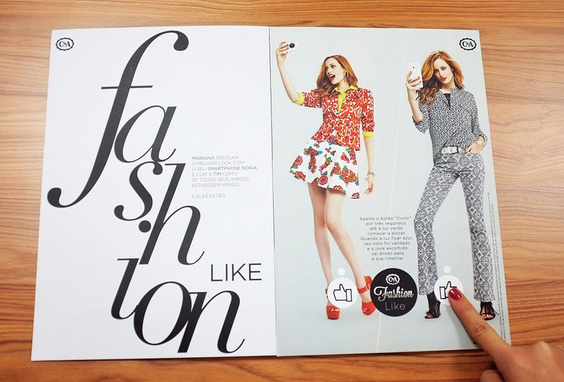 Interactive print advertisement by C&A fashion featuring printed social media Like buttons