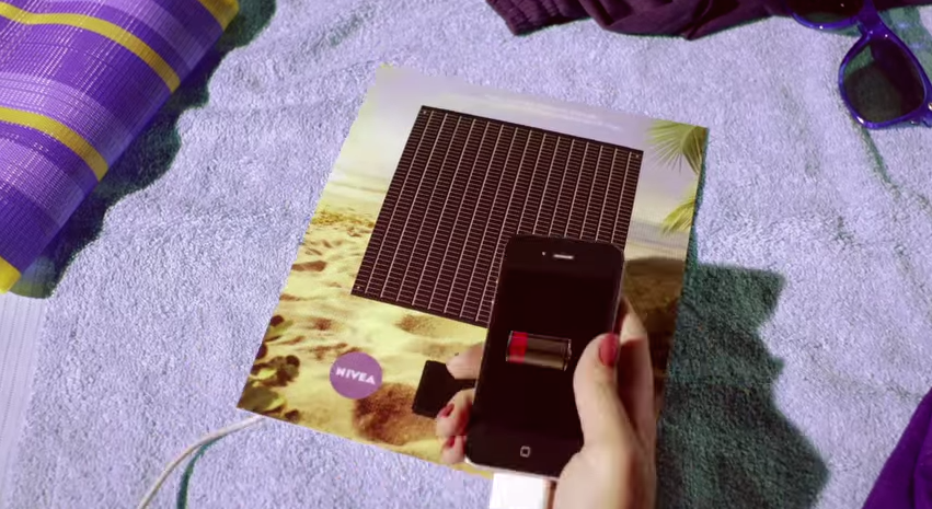 Interactive print advertisement by Nivea with solar-powered smartphone charger on back page of magazine