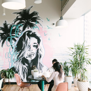Creative WeWork office space with mural and palm trees