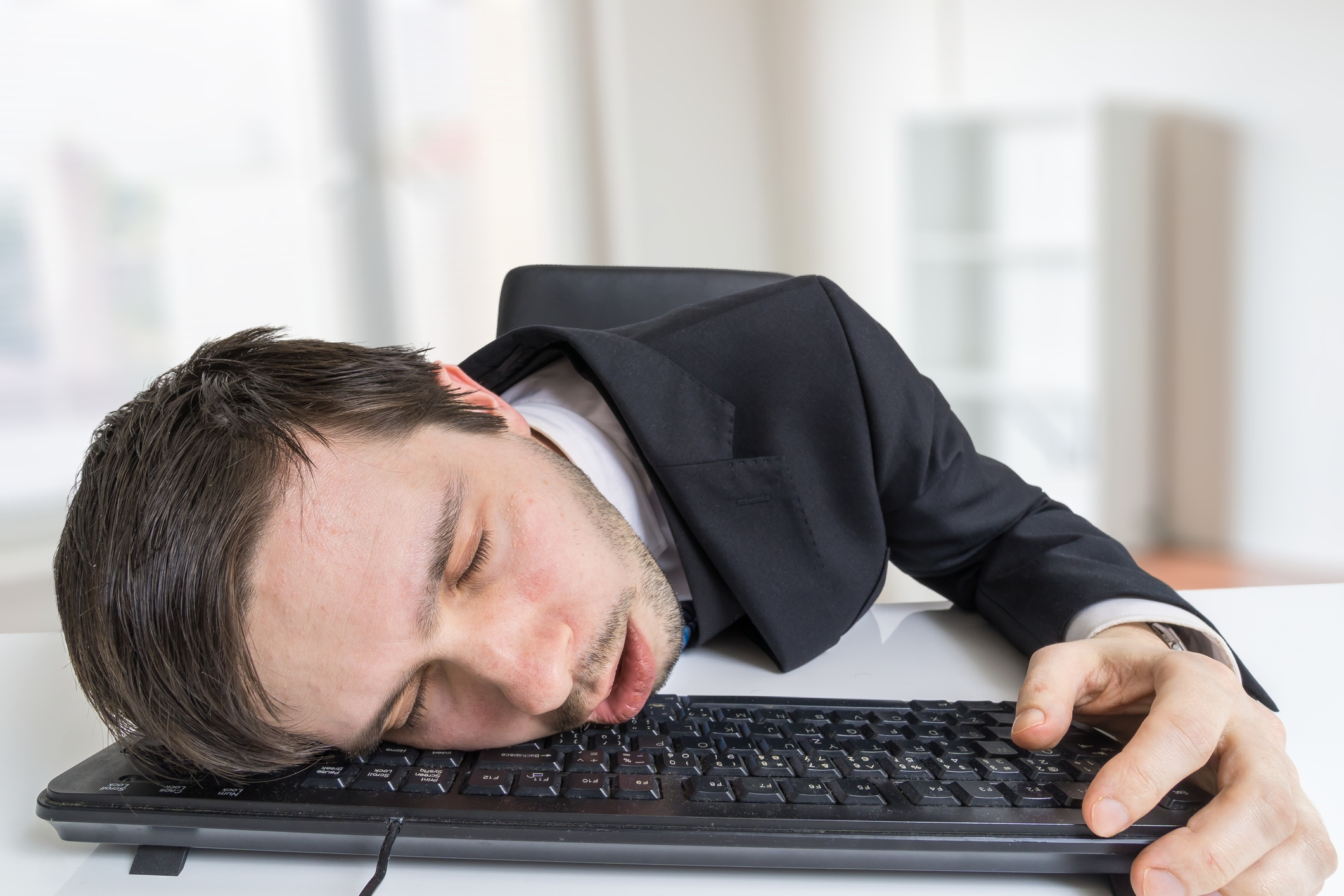 Man sleeping on keyboard