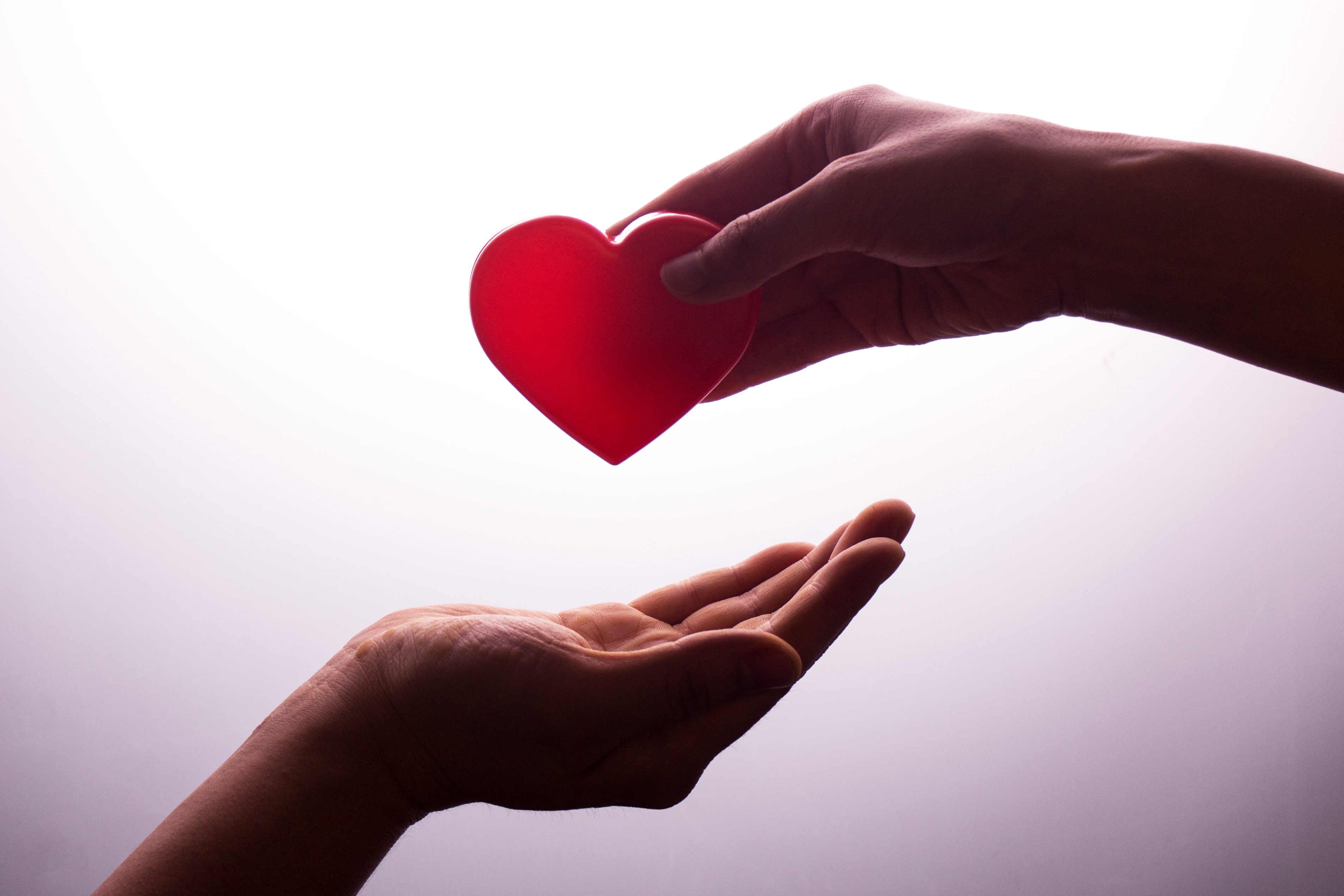 Passing heart from one hand to another