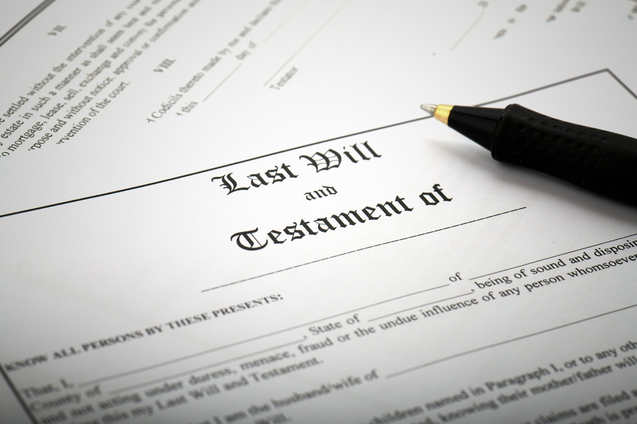 Last will and testament document with pen resting on top