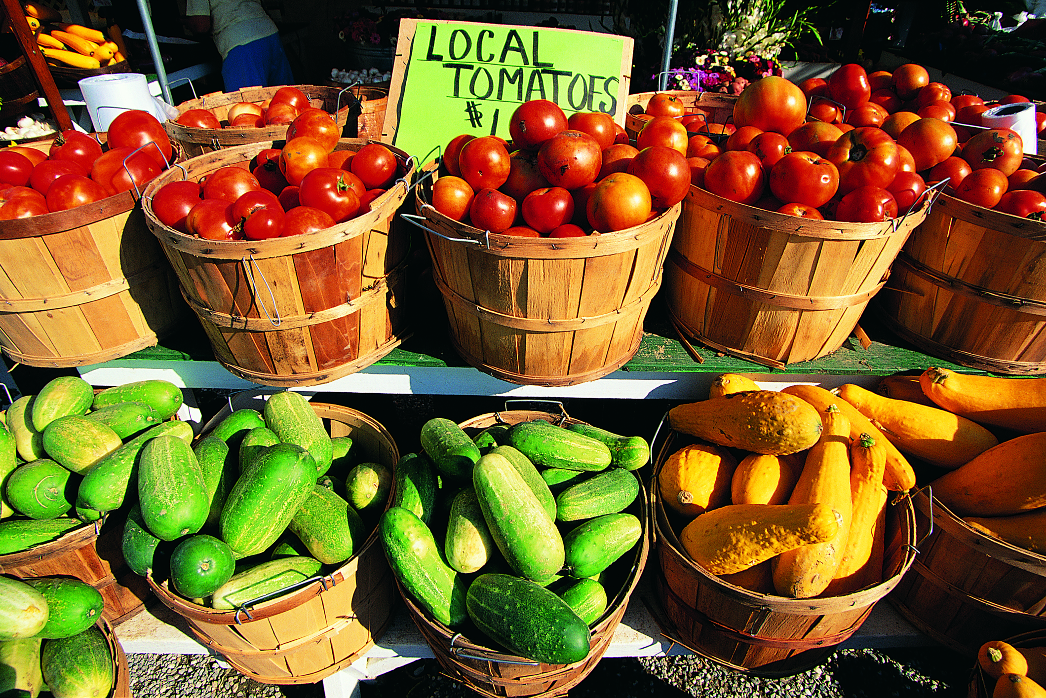 Local vegetables in buckets on a farmer's market table