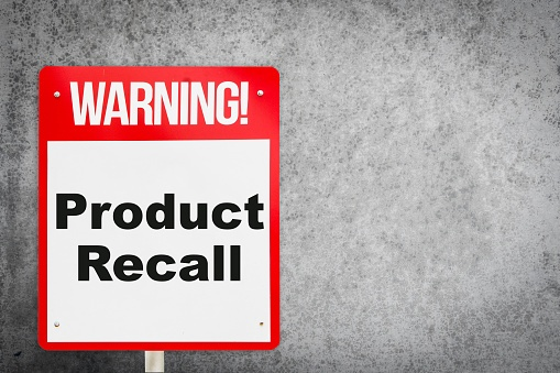 Red and white warning sign with grey background saying 22Warning! Product Recall22.jpg